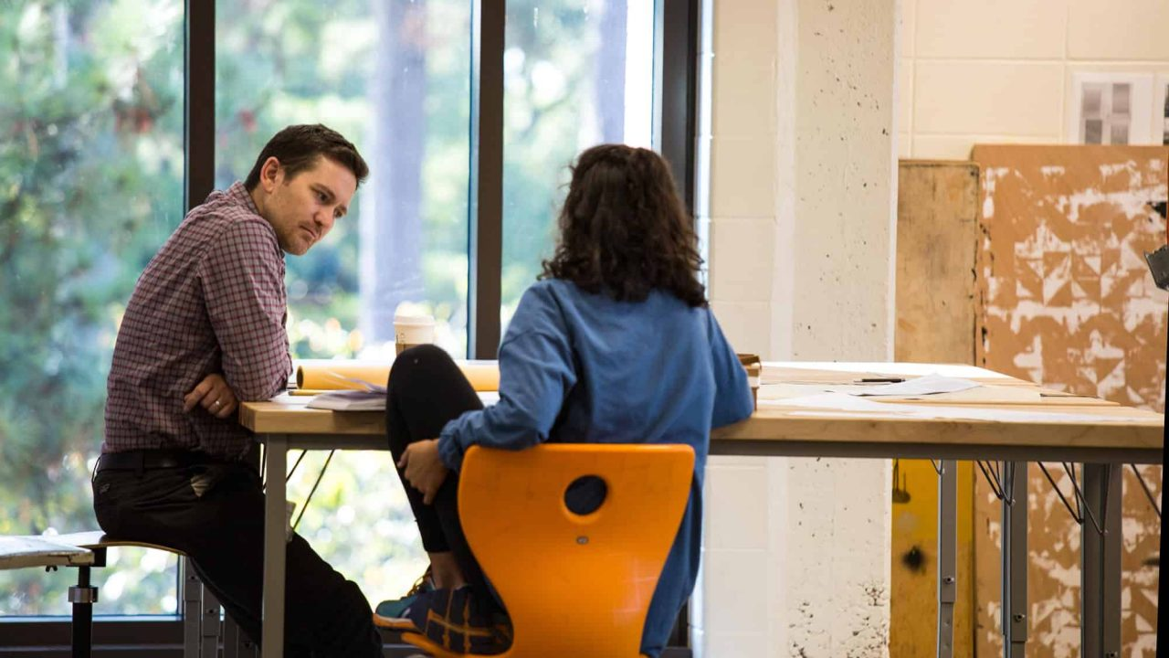 Professor Justin Miller speaking to architecture student