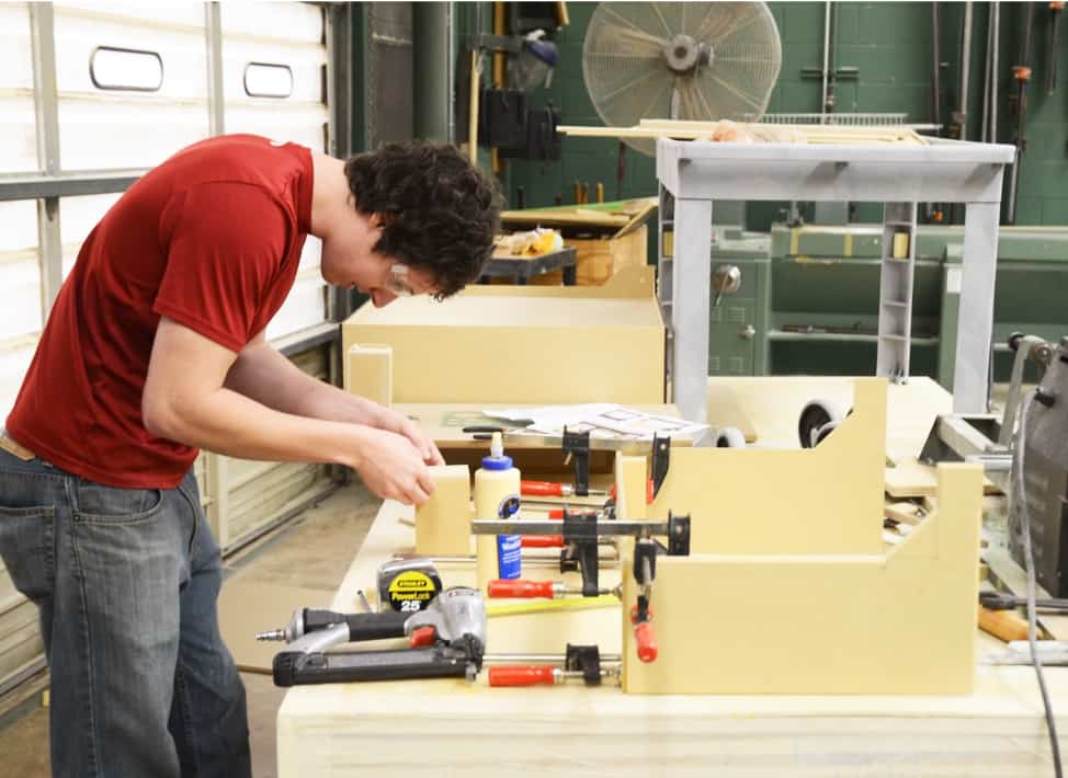 Industrial design student working on project in SIGD shop