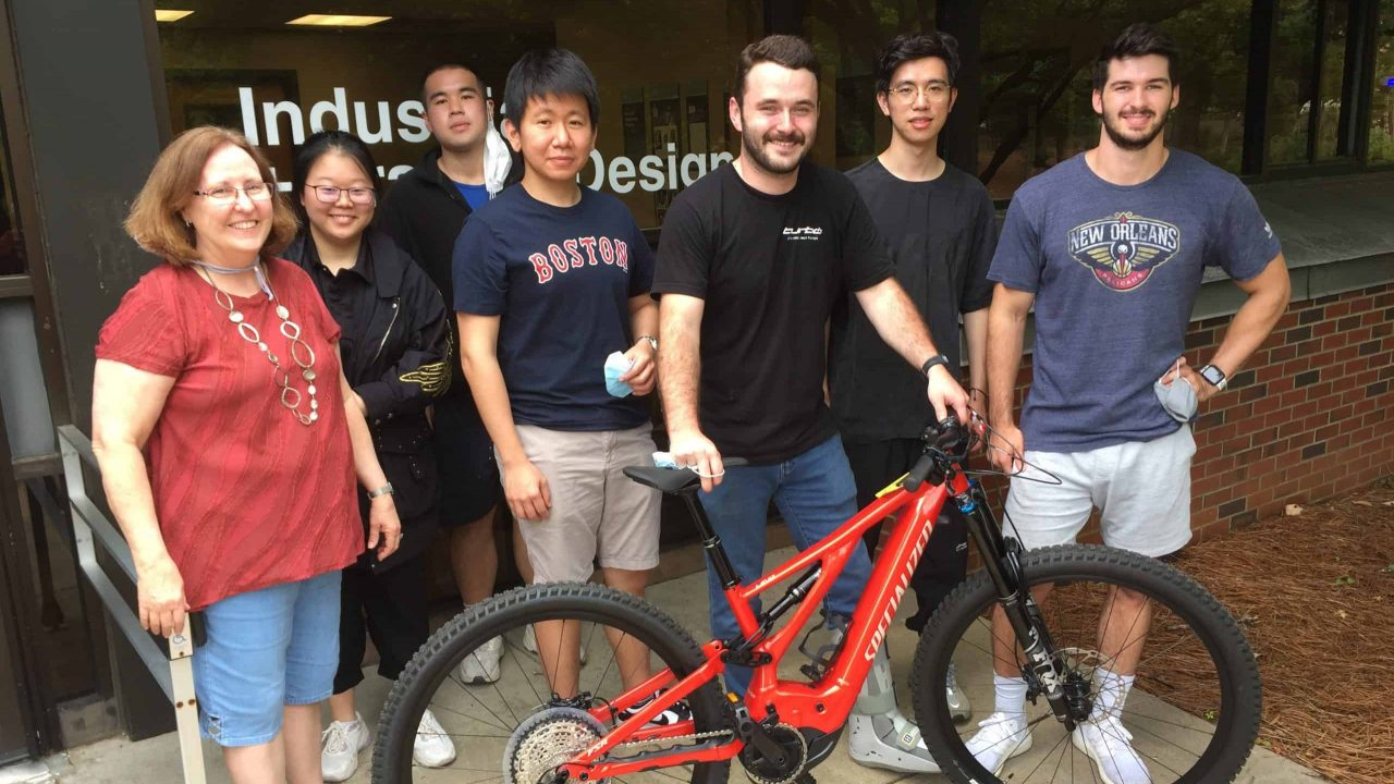 Students and faculty with e-bike